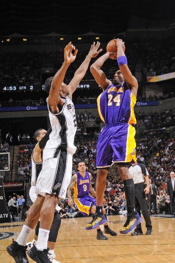 a0ba173a5bfbe7 APRIL 20  Kobe Bryant shoots against Kawhi Leonard of the San Antonio Spurs  on April 20