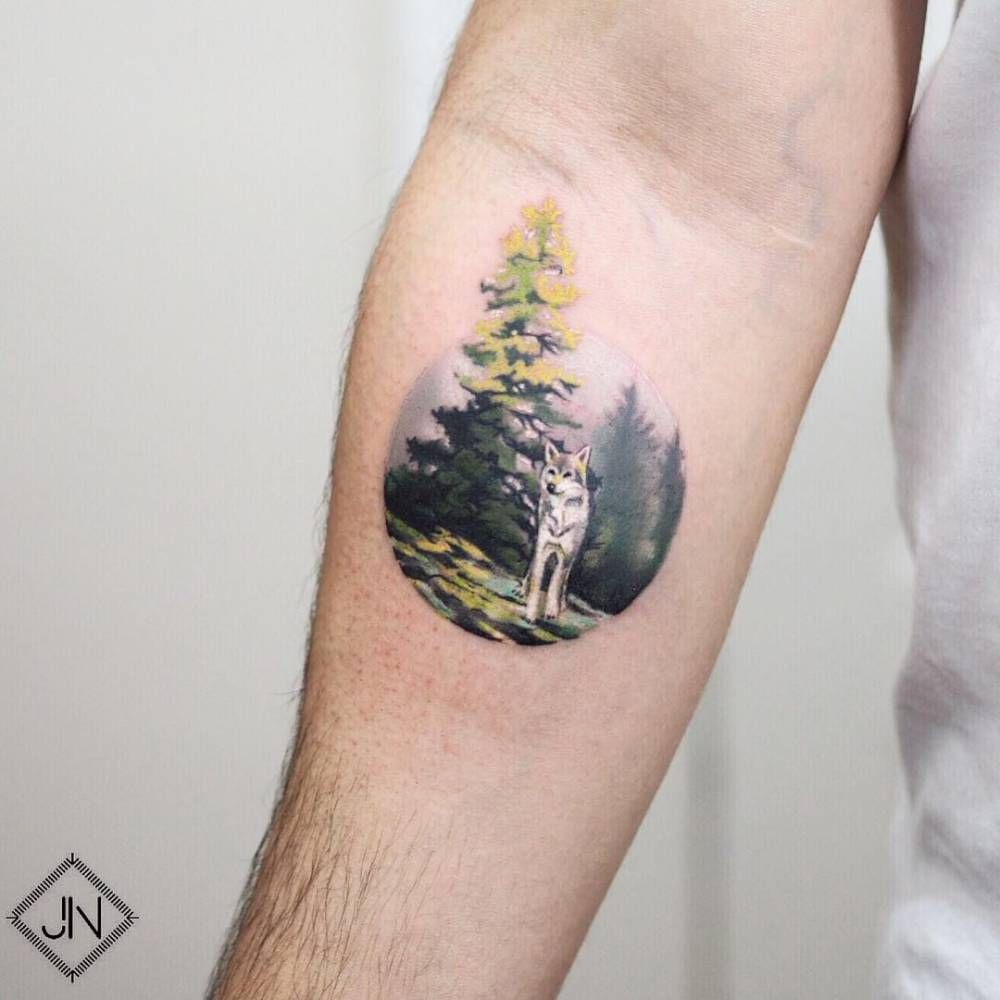 Wolf In The Forest Tattoo On The Inner Forearm. Tattoo