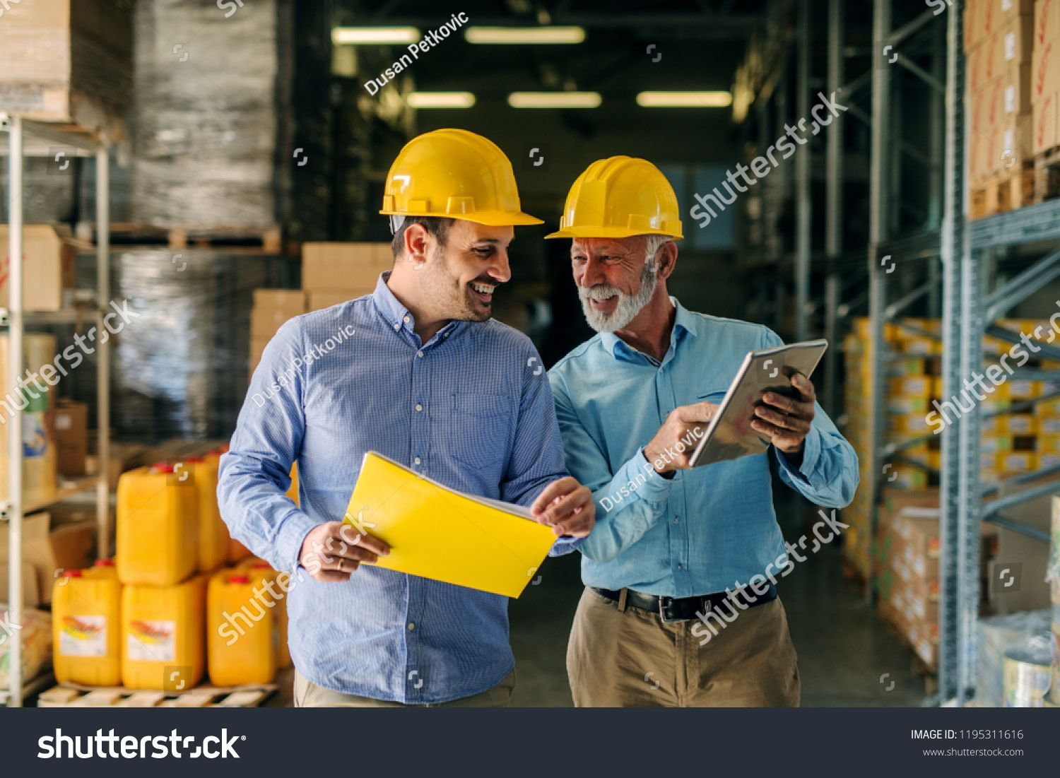 Two Successful Smiling Business Man Walking Through Big Warehouse