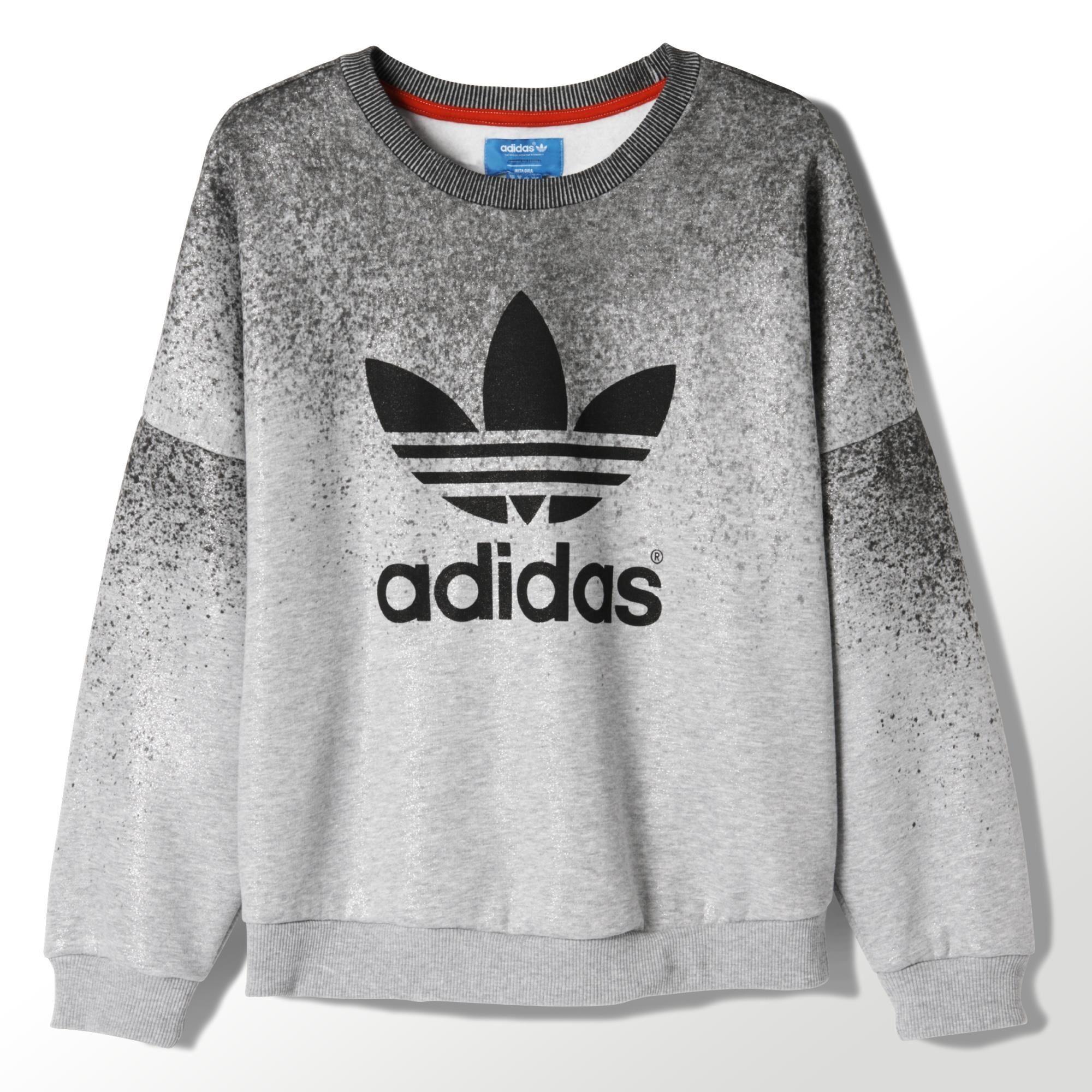 e91bd6f323412 Este suéter para mujeres con diseño de pintura salpicada es parte de la  colaboración entre adidas Originals y Rita Ora