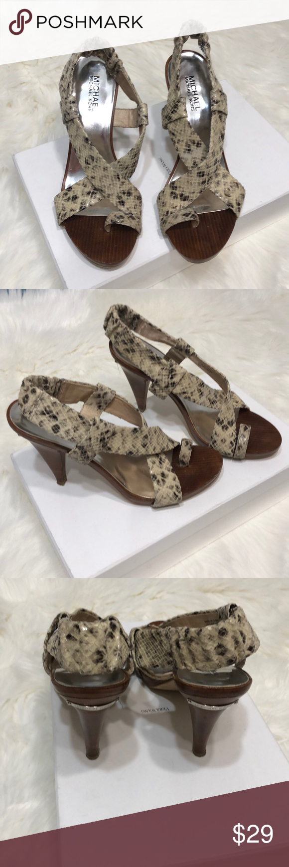 Michael Kors snake print size 8 sandals Michael Kors snake print size 8 sandals 4 in  Heel  5 in  Platform  Leather upper Rubber sole Lots of life left in these beauties  Signs of wear shown on the bo is part of Fashion -