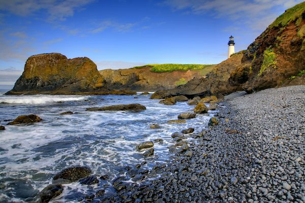 Yaquina Head Lighthouse In Newport Oregon Black Clobblestone Basalt Beach
