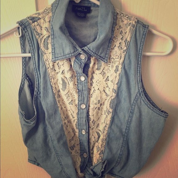 Denim tie top Size small from rue 21, denim vest top, ties at bottom, good condition no stains, damage, etc. worn only 2-3 times. Is made from 100% cotton. **SELLING FOR CHEAPER ON MERCARI** Rue 21 Tops Crop Tops