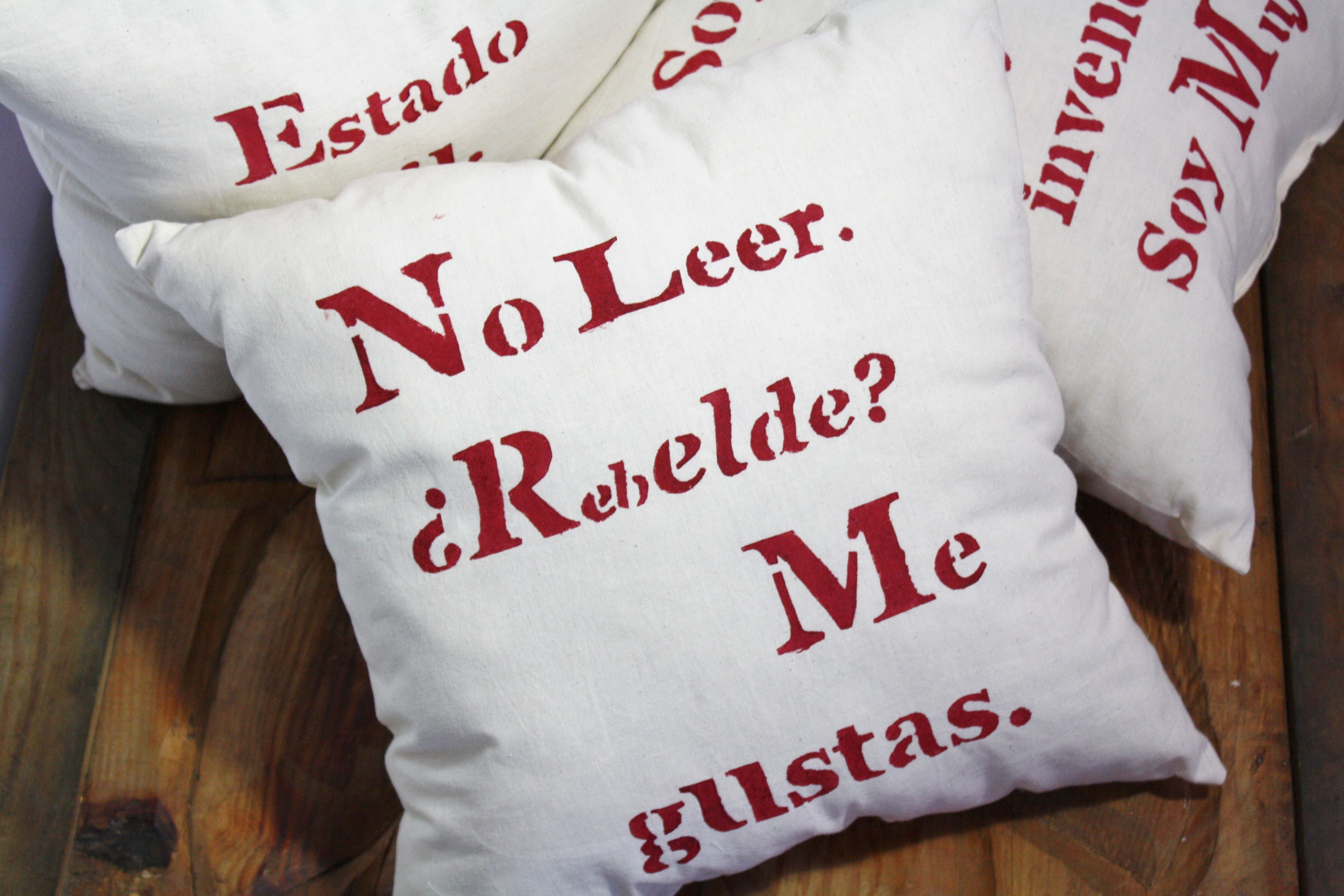"Square pillows (size 18"" x 18"") with messages that are meant to make you reflect and smile. Materials: Cotton, polyester filling, acrylic paint. Get them at Las Matrias in Etsy.com"