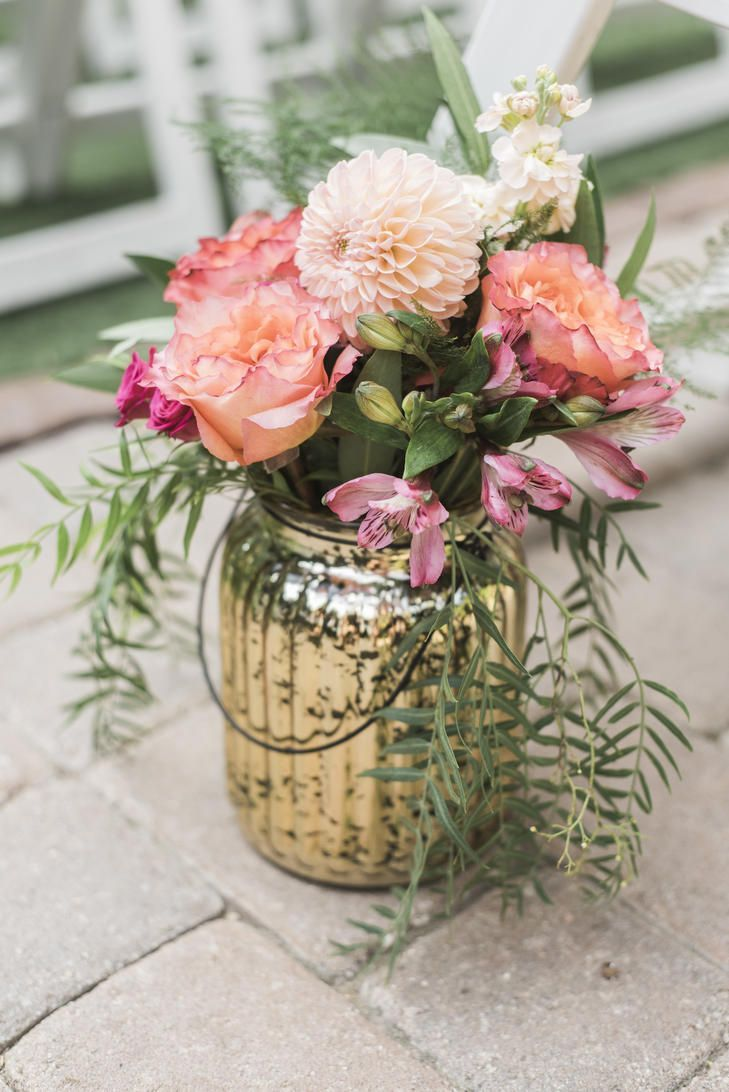 Make your aisle pop with this pink dahlia floral arrangement in make your aisle pop with this pink dahlia floral arrangement in mercury glass izmirmasajfo