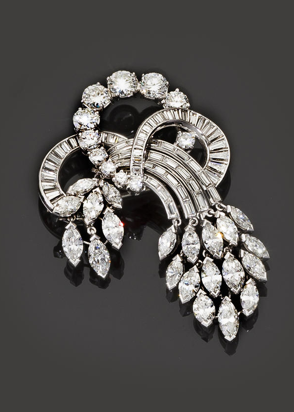 A diamond brooch, Harry Winston  designed as a curved spray of baguette and round brilliant