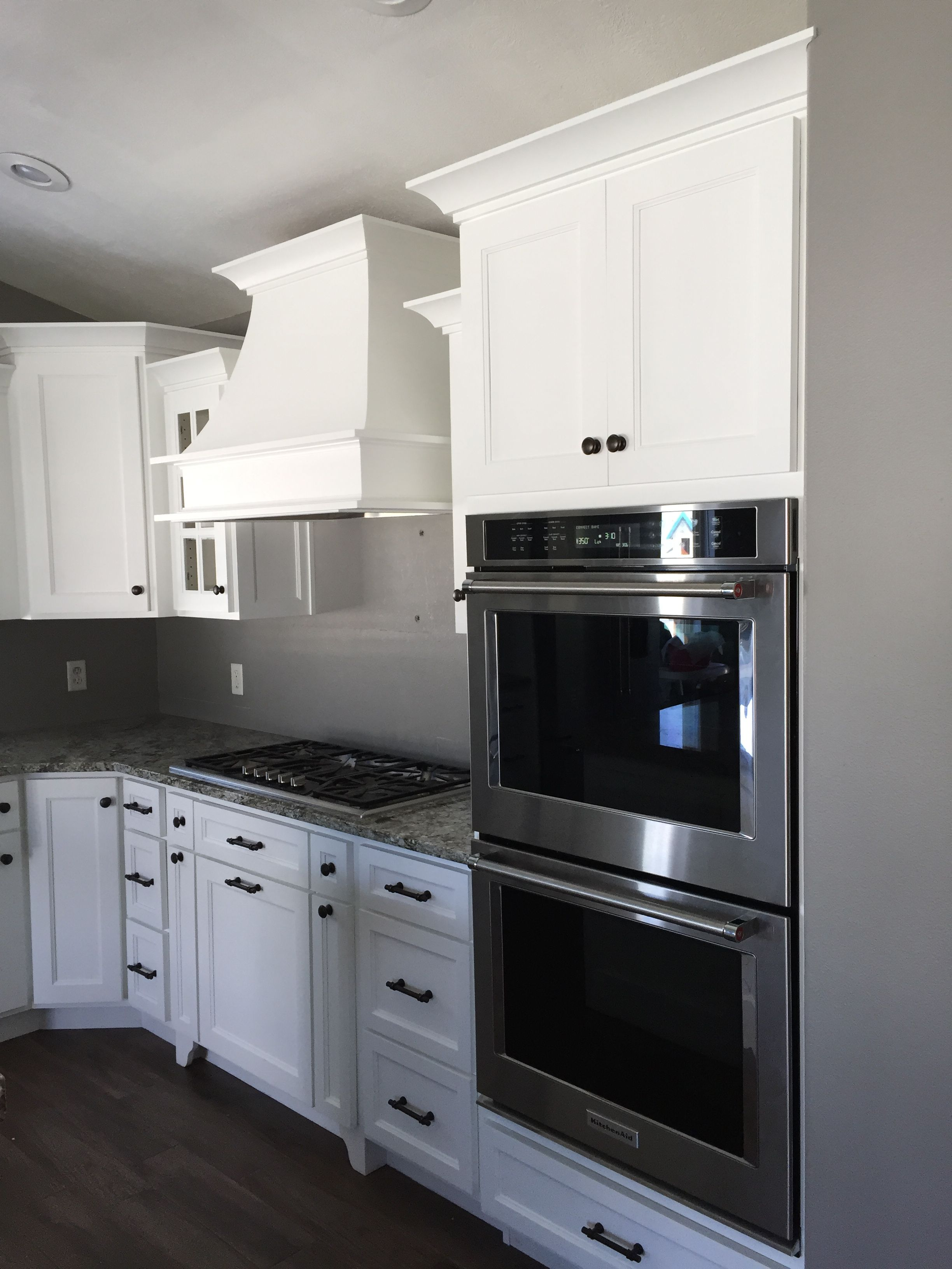 White Kitchen Cabinets With Double Oven Gas Cooktop And White Hood White Modern Kitchen White Kitchen Cabinets Modern White Kitchen Cabinets