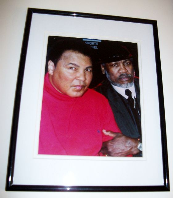 "Muhammad Ali & Joe Frazier  ""Reunion: The Peace of The Century""  Custom Framed Photograph  Includes a letter of authenticity   Overall Size: Approx. 11""x14""  Wholesale Cost (If Sold): $45.00  Starting Bid Price: $50.00  Value: $100.00"