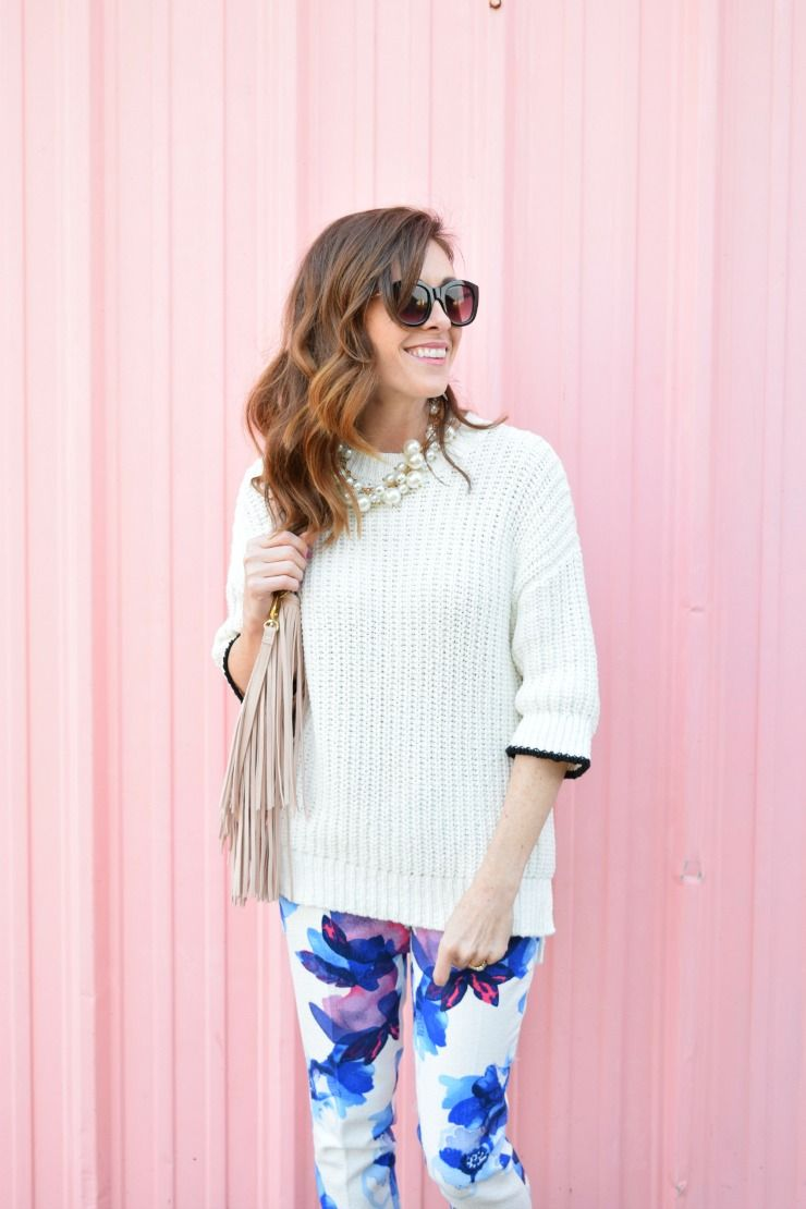 white knit sweater & floral pants with blue bow shoes from Kate Spade on Art in the Find
