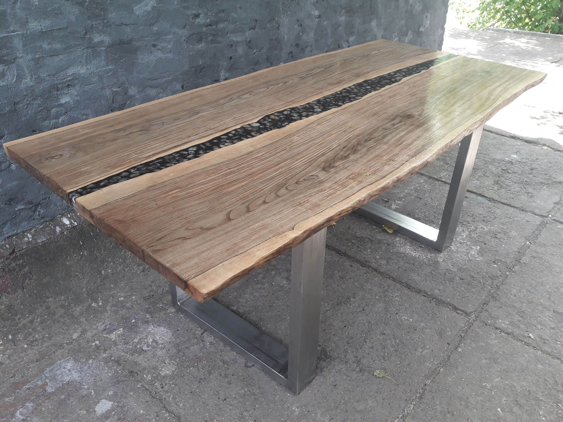 Live edge dining table of fossil maple wood with black resin a