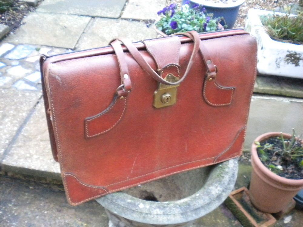 Original vintage/retro mans tan leather briefcase with unusual strap handles.
