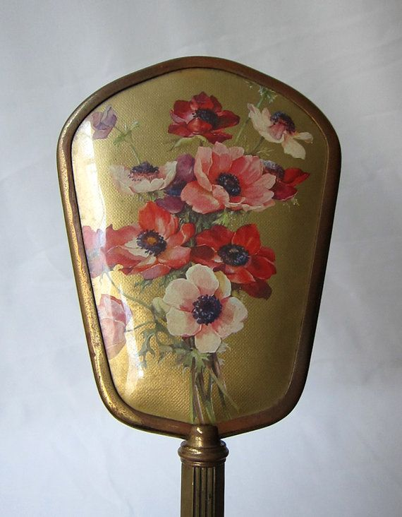 Antique art poppy hand mirror.