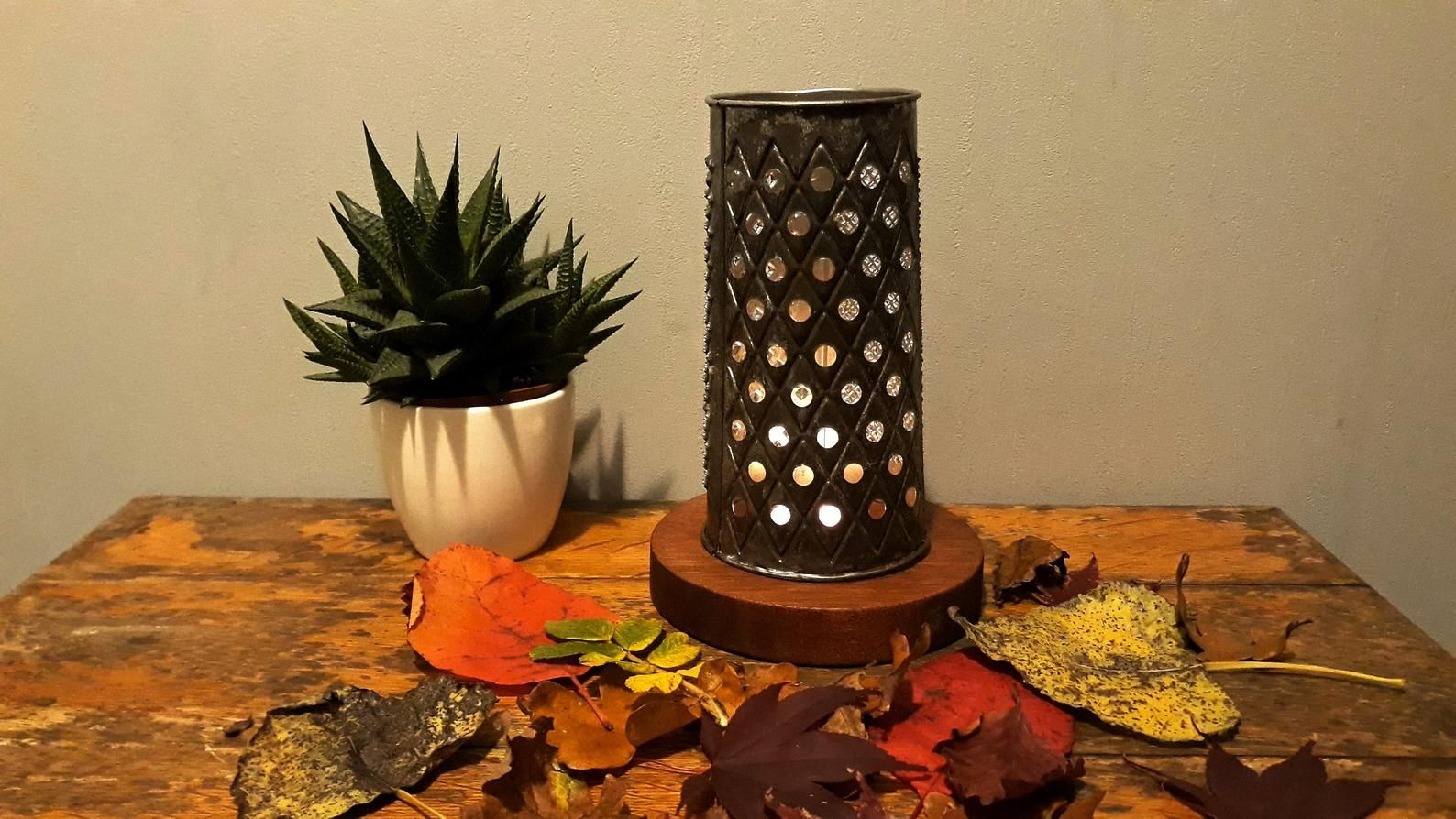 This candle holder will illuminate any tea light candle through the holes of the rusty vintage cheese grater. Full of character, beautifully aged and tarnished, dates to the 1950s -1960s. It sits on a reclaimed, hand crafted, natural finished round hardwood. The stand can be used in itself as a tea light holder, while the grater can be a great centerpiece of any farmhouse kitchen or part of a primitive christmas decorations.