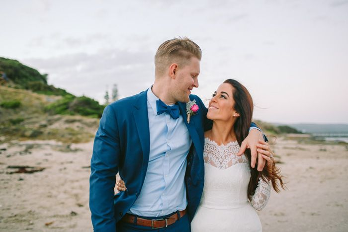 A long-sleeved Mariana Hardwick wedding gown and the groom in blue suit | I Take You