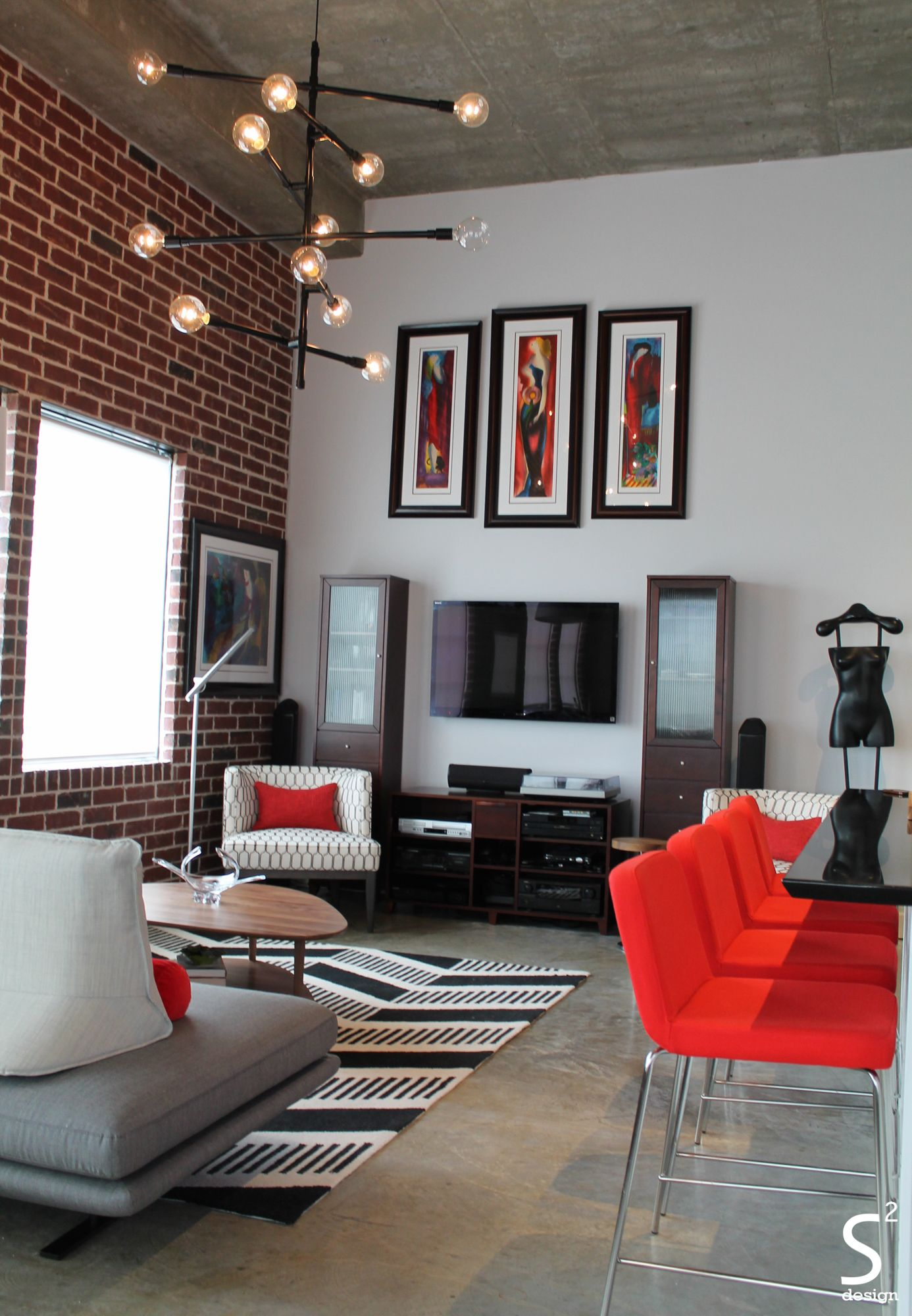 loft modern eliving room exposed brick wall black white red