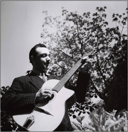 A Django Reinhardt pic I have not seen often!
