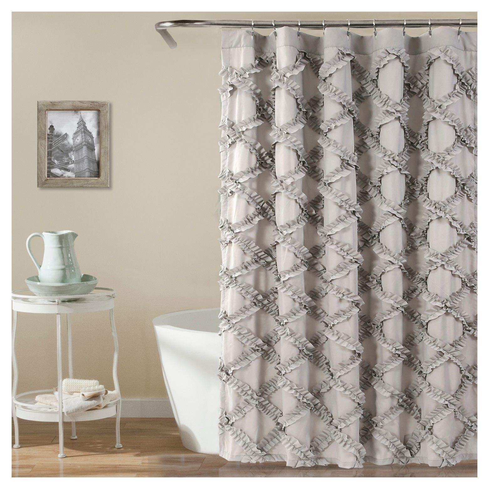 This Ruffle Diamond shower curtain will immediately enhance the look of your bathroom. The ruffle detail adds a feminine touch as well as eye-catching texture to instantly brighten the look of the room. Part of the Ruffle Diamond Collection.