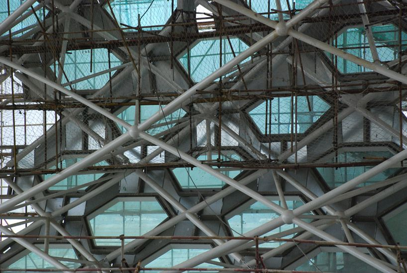 space frame structure secures the skin of the curtain wall image ...