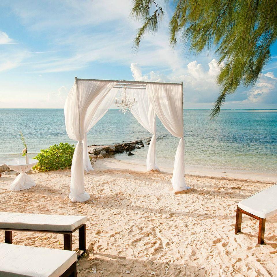 Caribbean Beach Wedding Ceremony In Grand Cayman At Seafire Resort Spa Caribbean Beach Wedding Cayman Island Wedding Destination Wedding Caribbean
