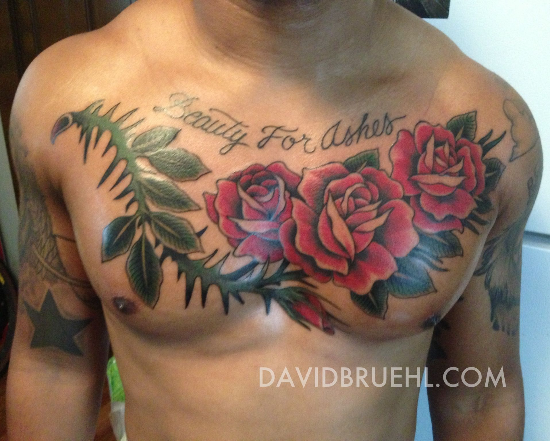 Beauty for ashes roses with thorns on a chest on dark for Ashes in tattoo ink