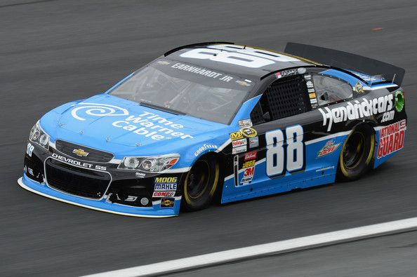 Dale Earnhardt Jr., driver of the #88 Time Warner Cable Chevrolet, practices for the NASCAR Sprint Cup Series Bank of America 500 at Charlotte Motor Speedway on October 10, 2013 in Concord, North Carolina.