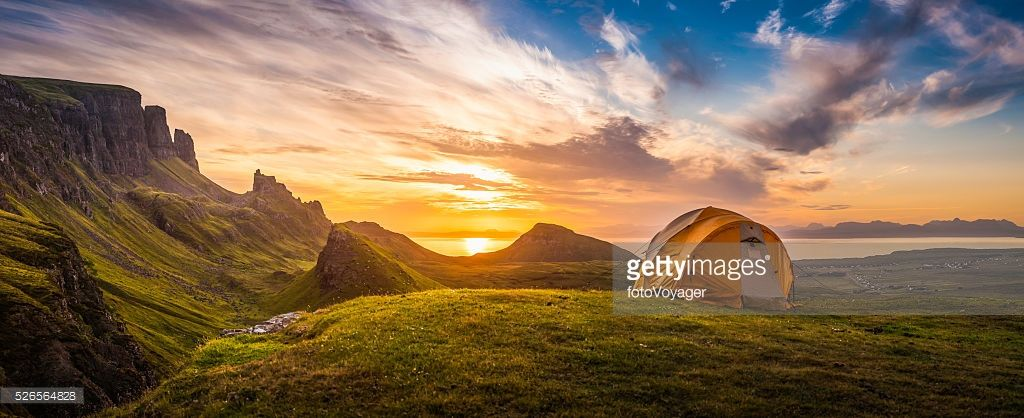 Dome tent illuminated by the warm glow of sunrise as a golden cloudscape reveals the dramatic & Dome tent illuminated by the warm glow of sunrise as a golden ...