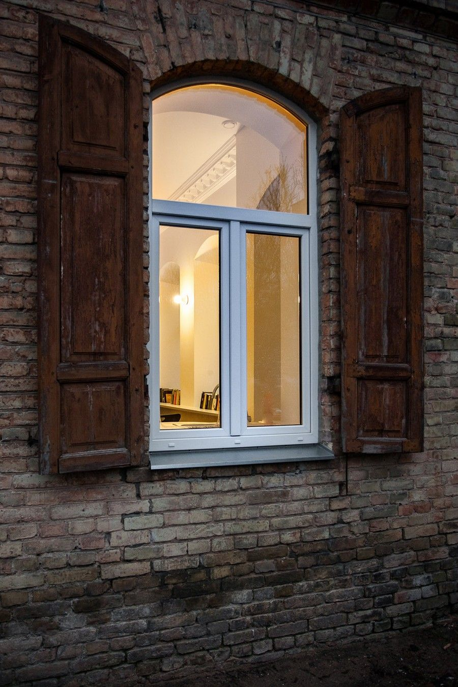 arched windows and shutters |  perfect exposed brick walling