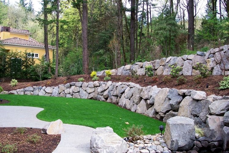Cascade Landscape And Design Cascadelandscapedesign Com Boulder Retaining Wall Rock Wall Landscape Landscaping Retaining Walls