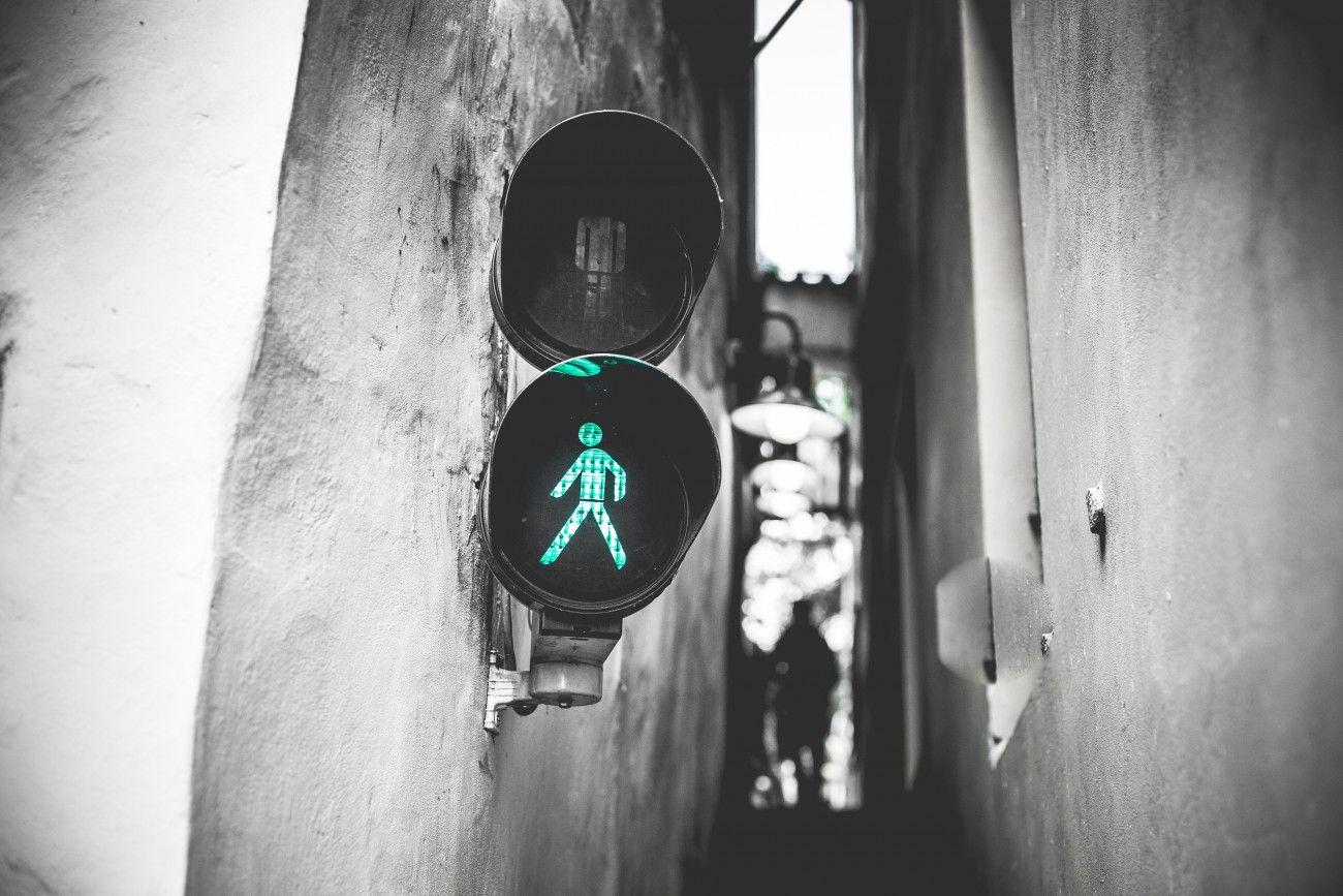 Green Traffic Light Walk Signal in Prague Narrowest Street