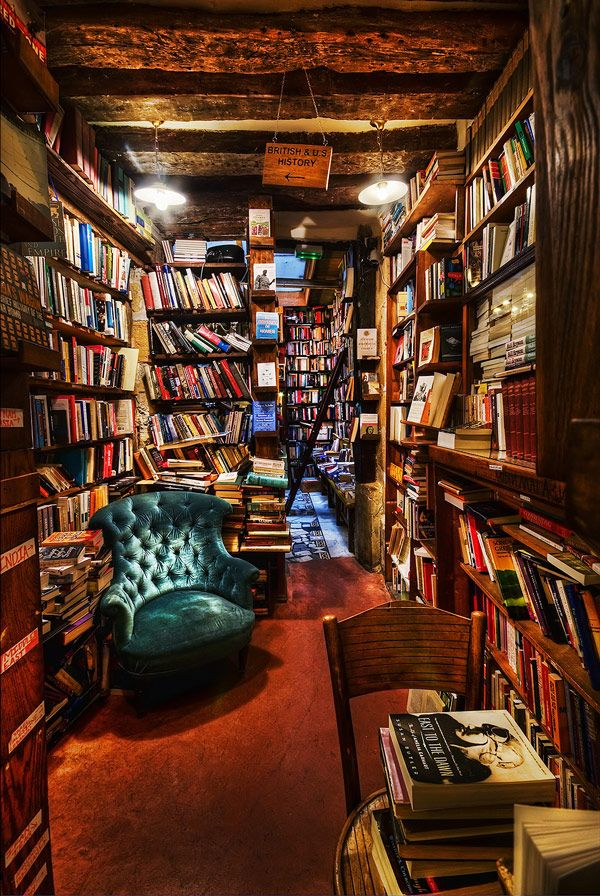 shakespeare & co., paris, france. books in perfect disarray.