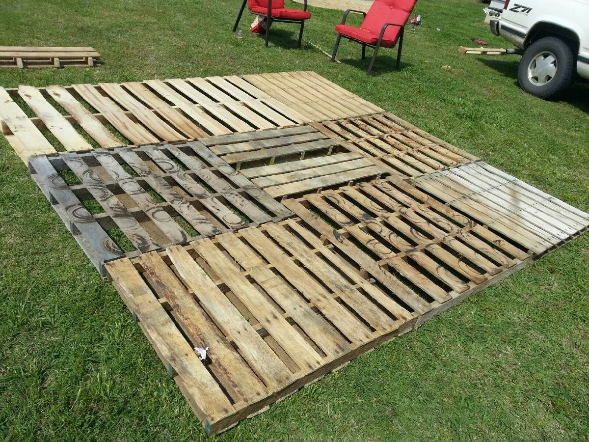 Pallet Patio Part 2 Squaring It Up And Getting It Level I Used Piece Of Scrap 1x4 And 2x4 To Level The Base Well Pallet Patio Pallet Patio Decks Backyard