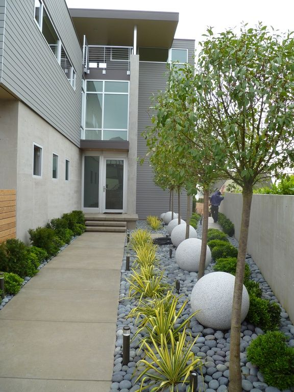 Contemporary landscape yard with fence french doors for Pebbles in backyard