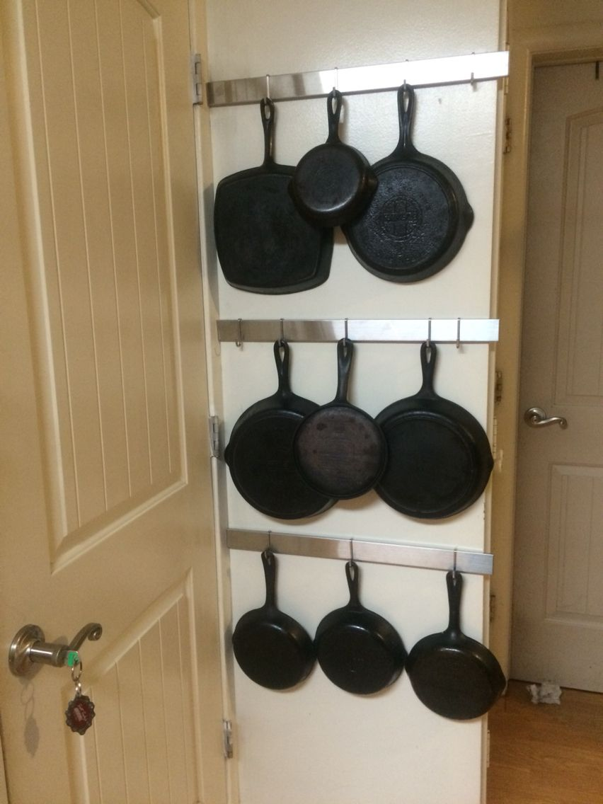 Cast Iron Pan Rack On The Wall Behind The Door Ikea