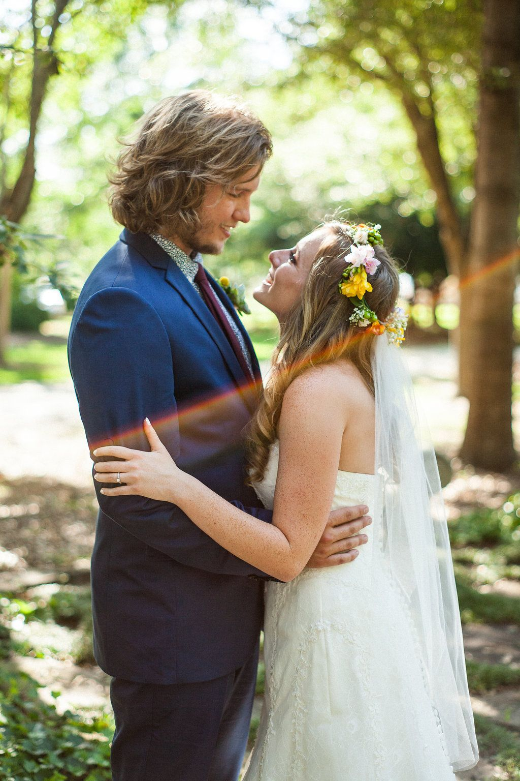 Bride and groom from a bohemian june wedding blue suit floral