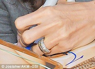 Angelina Jolie offers good look at her wedding jewelry Gold rings