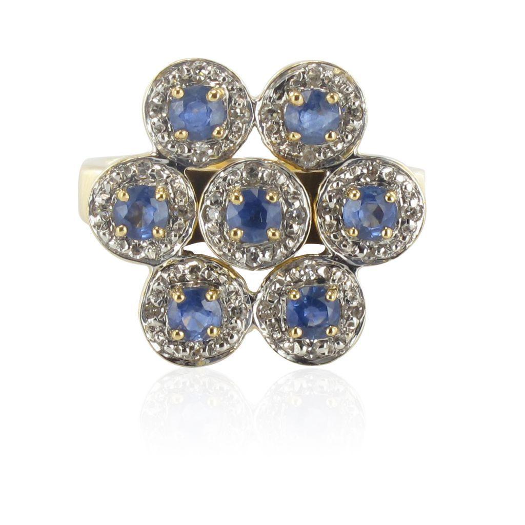Bague or jaune saphirs diamants. Les saphirs sont d'un bleu parfait et la forme de la bague est très originale.