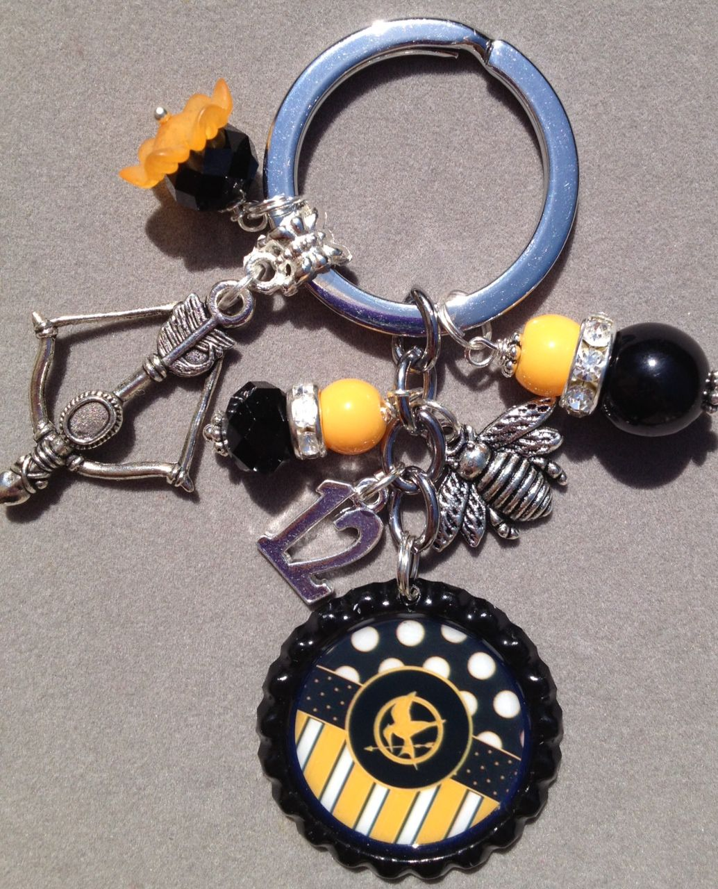 This Listing Is For One Hunger Games Inspired Bottle Cap Key Chain The Key Chain Is Embellished