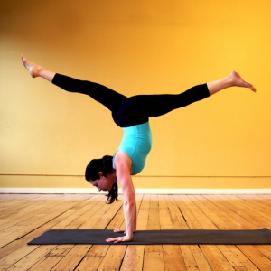 tips on mastering the handstand keep weight in the