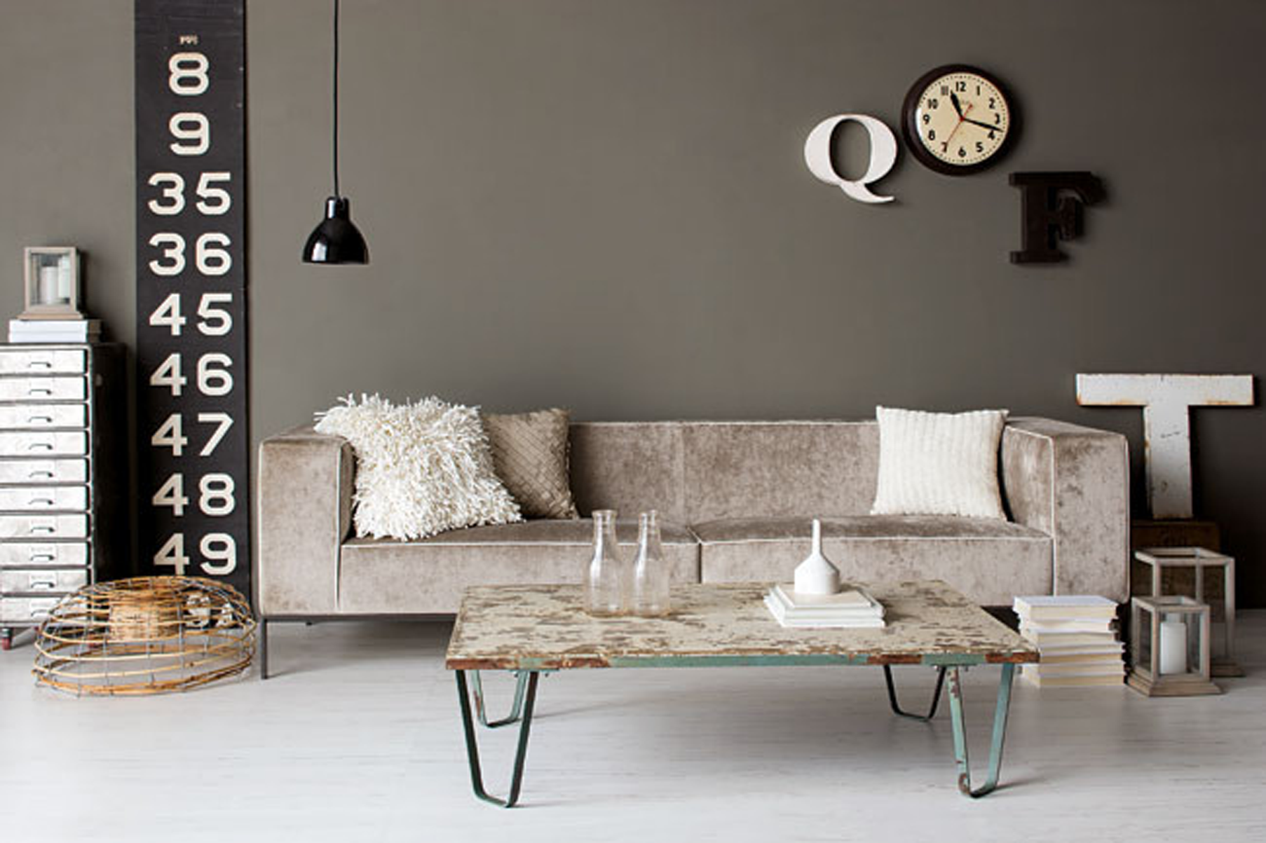 Industrial Chic image Square antique grey lanterns, 'Uki' sofa, distressed  antique coffee table and letters 'Q' and 'F' Orson & Blake