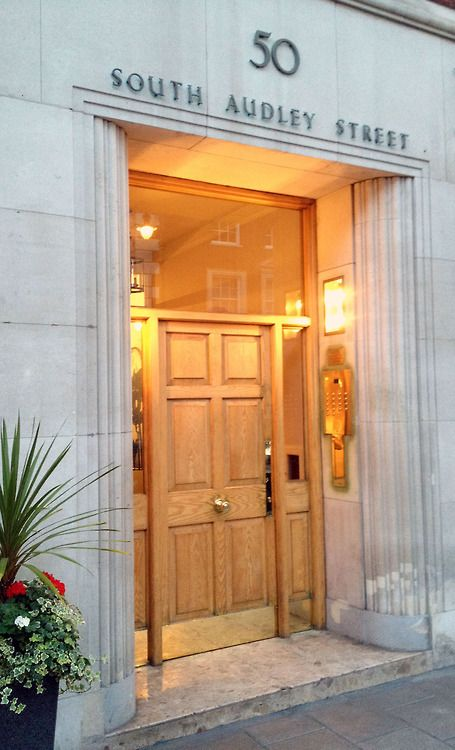 the art deco entrance at 50 south audley street in london is both