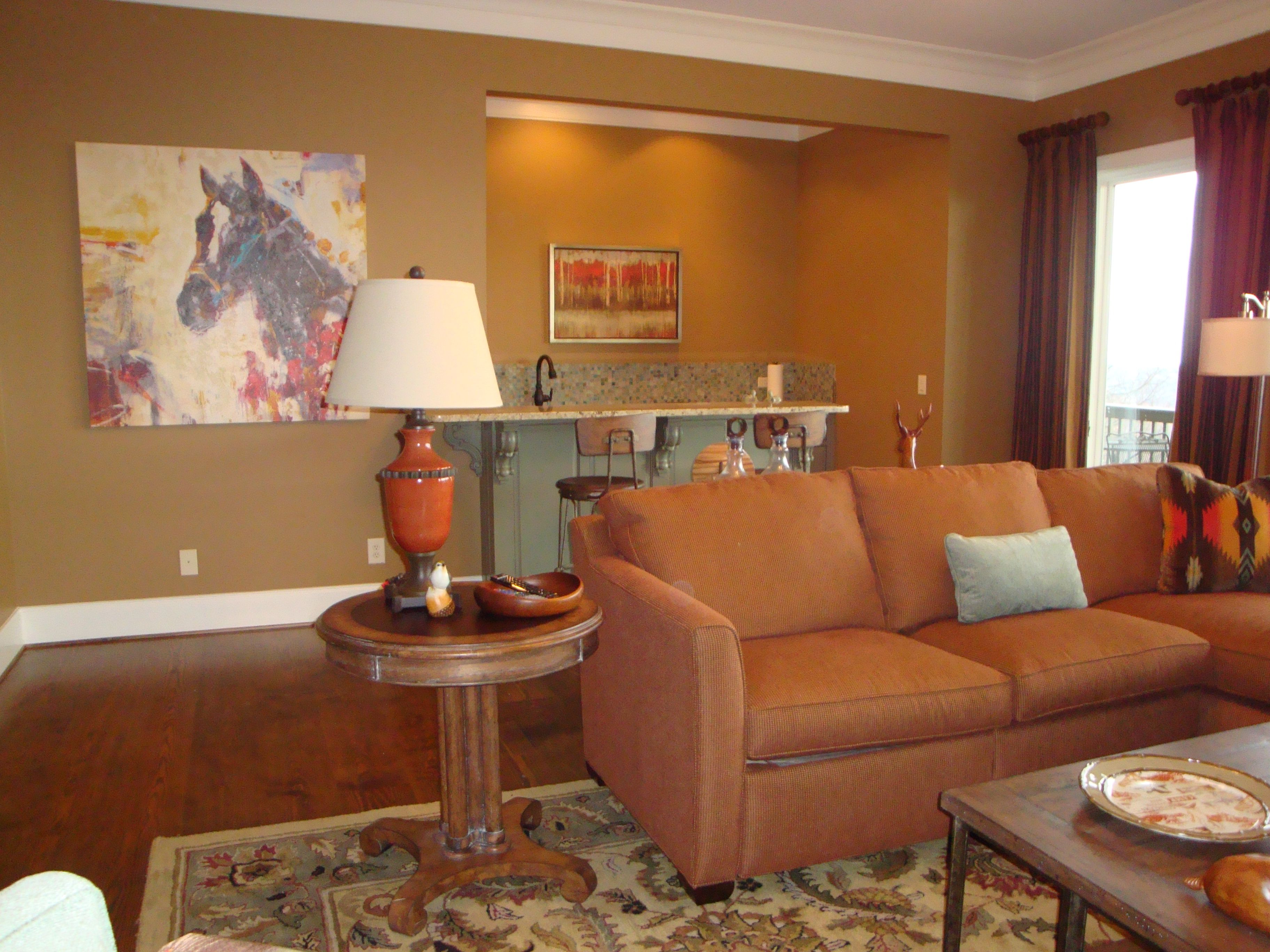 Home interior colour combination casual den with rust and teal color scheme panoply interior design