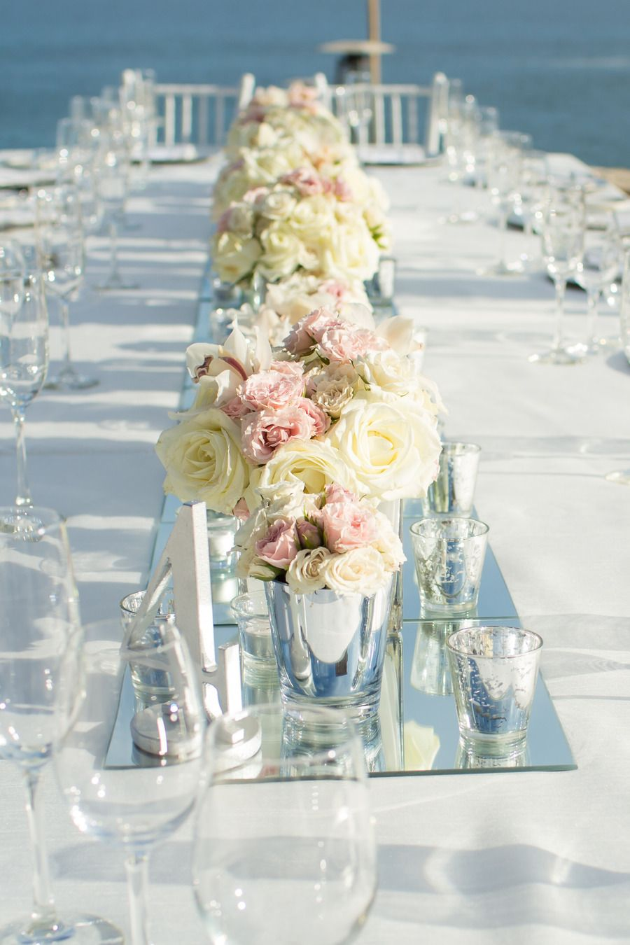 Beach wedding decoration ideas  Low Centerpieces with wall to wall mirrors See the wedding on SMP