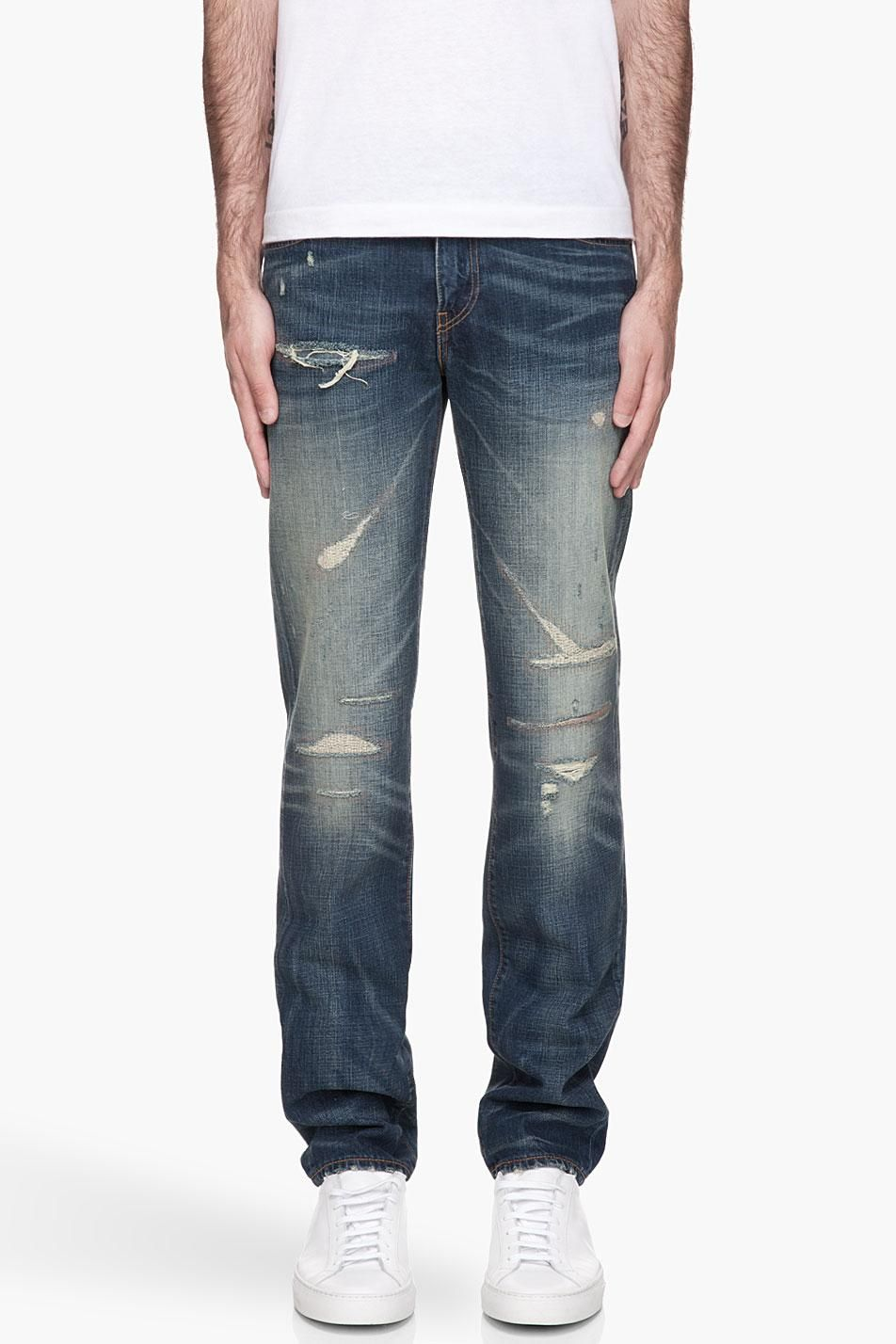 Levi's Blue faded and destressed 511 Slim Jeans