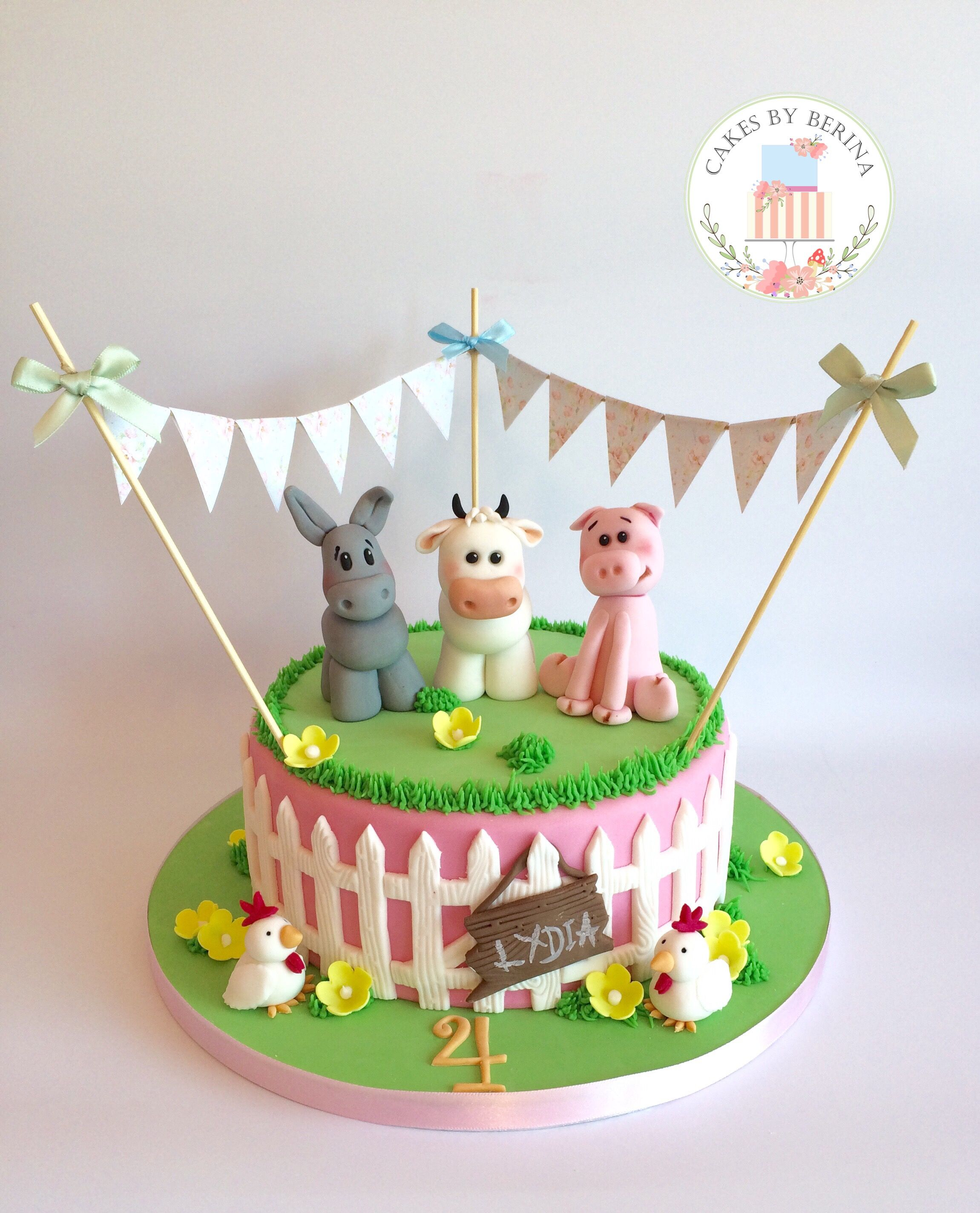 Girly farm animals birthday cake with edible cow donkey pig and