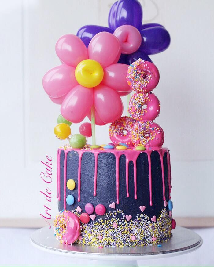 WOW Look At This Balloon Flower Cake With Pink Donuts And Chocolate Glaze Drizzle By Art De
