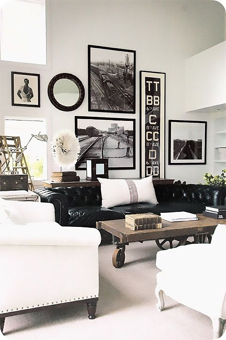 A Black And White Living Room With No Color Accents Is Hard To Pull Off,  But This One Looks Sleek And Stylish With The Custom Framed Accents.