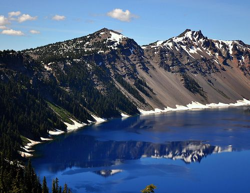 Crater lake formed when the volcano Mt. Mazama erupted approx 7500 years ago. Prior to the eruption, Mt. Mazama was 3700 m high, the highest point on the rim now is just below 2500 m. This is Crater Lake from Rim village