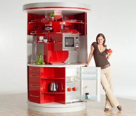 compact all-in-one kitchen station, a columnar design that rotates to reveal various functions and contents. It takes up a minimal amount of wall space, and manages to pack in a refrigerator, sink, microwave, dishwasher, surfaces, cupboards and cabinets into six square feet.