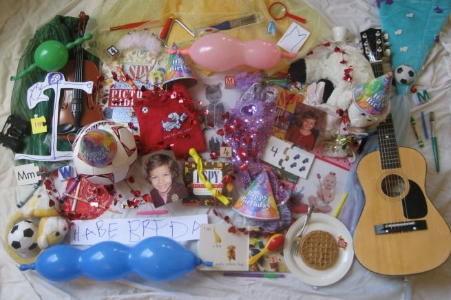 Homemade I Spy Picture used as an invitation for a 4th birthday. Inside: Find 4 balloons. 4 instruments. ETC.