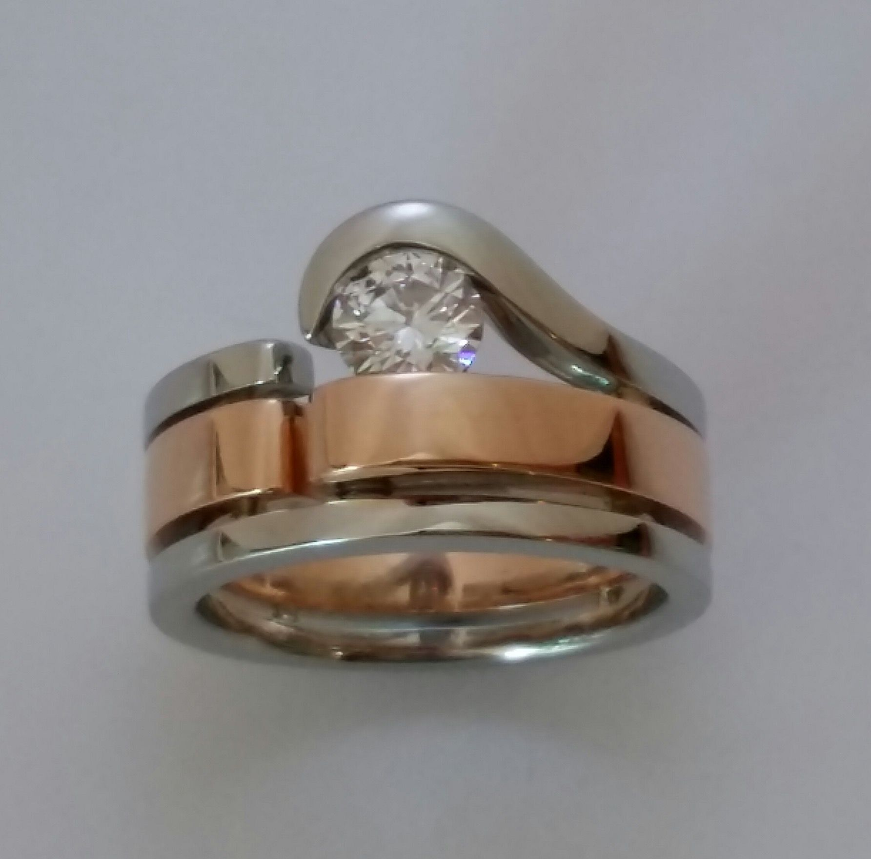 Handcrafted and one of a kind 19kt white gold, 18kt rose gold and diamond engagement ring